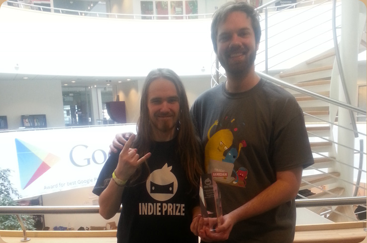"Jeff Jensen and Martin Bruun Pedersen flashing their ""MOST PROMISING GAME IN DEVELOPMENT"" award, 2014"